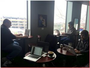 Three guys working at coffee shop